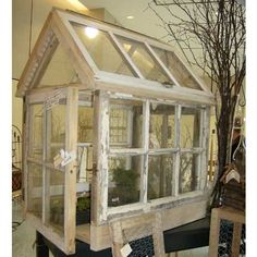 small greenhouse made of old windows