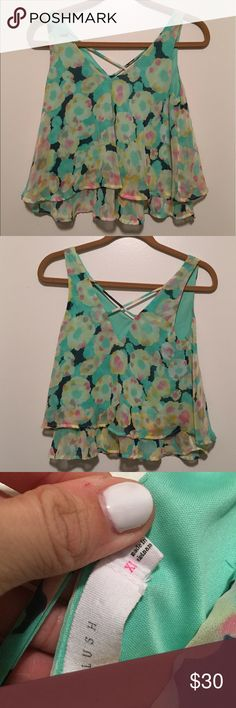 Beautiful green blue flower pattern tank Blouse Good condition! Beautiful pattern and colors! Great cross cross back strap detailing as well. Is a crop top tank flowy Blouse. Fits true to size Lush Tops Blouses