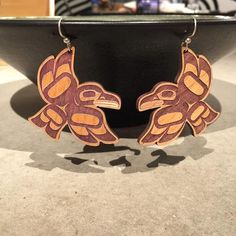 earrings dyed with wild blueberry juice, Trickster (Tlingit)