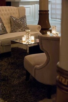 Sequined pillows on neutral couch