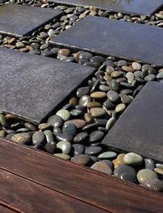 Modern backyard landscaping ideas with beach pebbles.