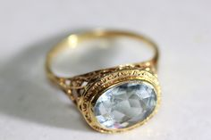 Metal Type: 14k Yellow Gold Primary Stone: Natural Aquamarine AAA Primary Stone Weight: 3.00 ct Total Ring Weight: 2.8 Grams Ring Face: 11 MM Ring Size: 6 3/4 Re sizable: Yes For Free Era: Art Deco