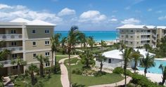 Alexandra Resort - Grace Bay Beach, Turks and Caicos.  Ocean Front Resort, Studios, 1, 2 and 4 Bedroom Suites in either garden, ocean or ocean front views. Gym, Tennis Courts, Non motorized water sports, bicycles, kids club, swimming pool, walking distances to shops and restaurants, and snorkelling off the beach