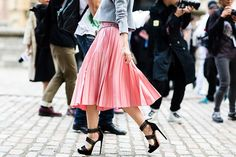 This bubblegum pink skirt and sky-high heel combo is nothing less than girly perfection.