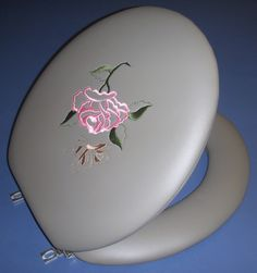 Embroidered Rose and Butterfly - designer padded toilet seats by World Wide Manufacturing Company in Florida