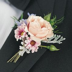 boutonniere: creamy peach rose, accented with pale blue delphinium and pink mums with Dusty Miller leaves