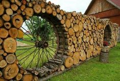 Awesome log fence with old wagon wheels!