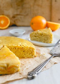 #AD This glazed orange cardamom cake is a wonderfully simple dessert bursting with winter citrus and spice. It's moist, hearty texture and sticky glaze make it perfect with a cup of tea. | @juicecentral #JuiceCentral