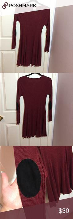 Maroon long sleeve dress Long sleeve dress with black patches on back of elbow. Ribbed sweater texture. Size medium. Never worn and has tags. Francesca's Collections Dresses Long Sleeve