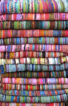 Woven Rugs of Many Colours, in Jaffa, Israel . Weaving Textiles, Textile Fabrics, Textile Art, Loom Weaving, Hand Weaving, The Design Files, Tear, Rug Hooking, Woven Rug