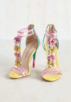 If your wardrobe is hungry for something zesty, serve up these T-strap pumps! Providing your style with a healthy helping of soft lime, teal, pink, mulberry, and crimson stripes - with a garnish of rhinestone-detailed flower embellishments - these heels are freshly picked to suit your fashion cravings.
