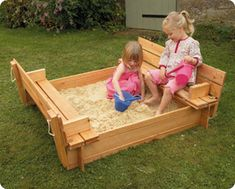 wooden sand pit with seats...the seats fold down to make the cover
