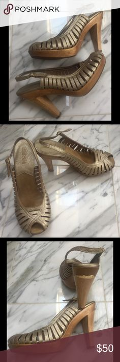 MICHAEL KORS CAVIER GOLD LEATHER PLATFORMS MICHAEL KORS CAVIER GOLD LEATHER PLATFORM WOOD HEELS , SUEDE & LEATHER FOOTBEDS ,NWOT, GOLD LOGO'S ON BACK OF HEELS ,NEVER WORN Michael Kors Shoes Platforms