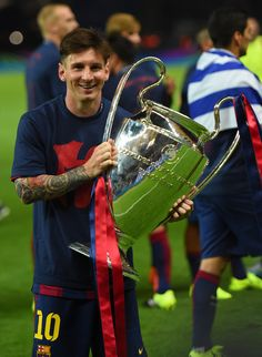 Lionel Messi of Barcelona celebrates with the trophy after the UEFA Champions League Final between Juventus and FC Barcelona at Olympiastadion on June 6, 2015 in Berlin, Germany.