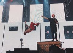 It looks like Tyler is dropping the mic but instead of dropping the mic he's dropping josh