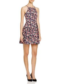 """Aqua Floral Fit and Flare Dress   Polyester/spandex   Hand wash   Made in USA   Square neck, sleeveless, allover print, pullover style   Approx. 33"""" from back of neck to hem, based on a size small   W"""