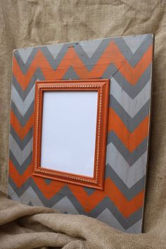 Cute frame. I'd use light blue and red or yellow and gray.