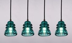 Farmhouse light fixtures from old glass insulators. FINALLY something to do with all of those blue insulators at the store!
