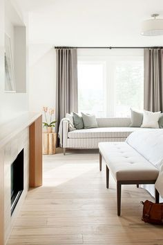 Warm neutrals in a bedroom with striped sofa
