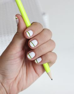 Neon stripe nails.