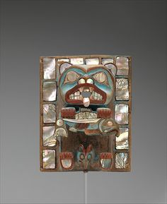 Headdress Frontlet Date: 1880–1900 Geography: Canada, British Columbia Culture: Tsimshian (?) Medium: Wood, paint, shell Dimensions: H. 7 5/16 x W. 5 3/4 x D. 2 in. (18.6 x 14.6 x 5.1 cm) Classification: Wood-Ornaments Credit Line: The Michael C. Rockefeller Memorial Collection, Bequest of Nelson A. Rockefeller, 1979 Accession Number: 1979.206.443