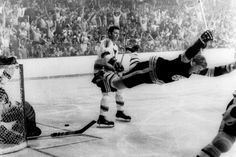 Boston Bruins' Bobby Orr goes into the air after being tripped, right after scoring the overtime goal against the St. Louis Blues that won the Stanley Cup for the Bruins in Boston. May 10, 1970