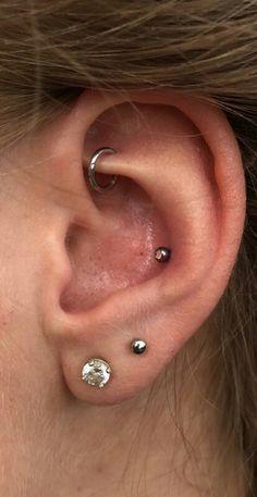 Double lobe piercing, rook piercing with ring hoop and new conch piercing. Still… Double lobe piercing, rook piercing with ring hoop and new conch piercing. Still…,Tattoo Double lobe piercing, rook piercing with ring hoop. Conch Piercings, Daith Piercing, Piercing Tattoo, Double Lobe Piercing, Piercing Face, Ear Peircings, Smiley Piercing, Cute Ear Piercings, Body Piercings