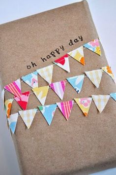 Mini paper bunting on a present #giftwrap #giftwrap