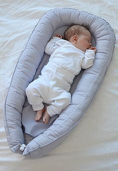 "A baby nest from Sweden.  ""Babynest is a mattress with high, soft edges wich offers a cozy and narrow sleeping area. In Babynest your baby will sleep very well. It is soft, cozy and narrow just like in the womb. Babynest soft edges are designed so you still keep eye contact with your baby when lying next to it. Edges are also soft enough to lay down on when breastfeeding if needed."""