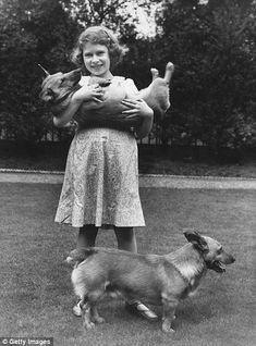 The then Princess Elizabeth (now Queen Elizabeth II) with two of her pet corgi dogs at her home in London in July 1936.