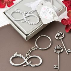 Infinity Design Key Chain Wedding Favors (FashionCraft 5266) | Buy at Wedding Favors Unlimited (http://www.weddingfavorsunlimited.com/infinity_design_key_chain_wedding_favors.html).