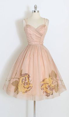 ➳ vintage 1950s dress * gorgeous organza dress * painted yellow rose print * ruched bodice with double strap * acetate lining * metal back zipper * dead stock with original Marshall Fields tags * by Sabett of CA condition | excellent fits like xs length 43 bodice 16 bust 32-36 waist 24-25 generous seam allowance at bodice some clothes may be clipped on dress form to show best fit for appropriate size. ➳ shop http://www.etsy.com/shop/millstreetvintage?ref=si_shop...