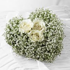 casket sprays babys breath | Baby's breath and white spray roses in a heart-shaped arrangement