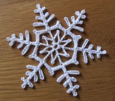 "Snowflake snowflakes - from the book Crocheted Snowflakes"" by Barbara Christopher.snowflakes - from the book Crocheted Snowflakes"" by Barbara Christopher. Crochet Snowflake Pattern, Crochet Stars, Crochet Motifs, Crochet Snowflakes, Thread Crochet, Crochet Flowers, Knit Crochet, Crochet Christmas Ornaments, Christmas Crochet Patterns"