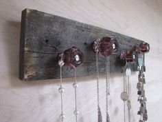 Upcycled Salvaged Wood Jewelry Holder Necklace Organizer with Purple Knobs. $42.00, via Etsy.