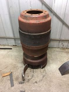 Brake Drum Potbelly Heater: 13 Steps (with Pictures) Diy Heater, Stove, Drums, Planter Pots, Wood, Outdoor Decor, Pictures, Fire, Projects
