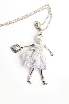"- ""New Beginnings"" Angel Pendant with chain necklace and extra clip to double as a charm or key chain. - 30"" Chain, Angel: 1-13/16"" wide x 4"" tall. - Jacqueline Kent. - Believe, Have Faith Miracles Do"