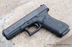 If I had to go into combat *this* is the handgun I would take with me. Glock 22. Legendary toughness and reliability, with 15 rounds of .40 S&W, traveling at 1100+ feet per second, impacting at 500 foot-lbs of pressure.