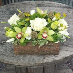 pretty earthy tones. centerpiece made with a real log container.  #atlanta_flowerbar #atlantaflowerbar #atlantaweddingflorist #atlantaflorist Flower Bar, Cake Flowers, Earthy, Atlanta, Succulents, Centerpieces, Floral Wreath, Reception, Container