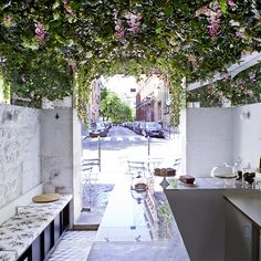 Paris-based designer Marie Deroudilhe dreamed a tiny, flower-filled cafe  sanctuary for Lily of the Valley.