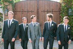 Great look! Lighter grey for groom, darker for groomsmen. Not so much the skinny ties though.