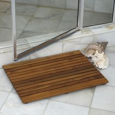 @Overstock - This Le spa Premium Plantation Teak Floor Mat is designed for use as a shower mat, in a spa, sauna, or steam room, as a door mat, or at your pool. This mat is machine-made for the perfect precision cut and fit.  http://www.overstock.com/Home-Garden/Le-spa-Teak-Floor-Mat/6218506/product.html?CID=214117 $72.55