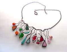 Statement stained glass and beaded necklace. An extremely dynamic, vibrant, colorful necklace Despite all the eccentricity and…