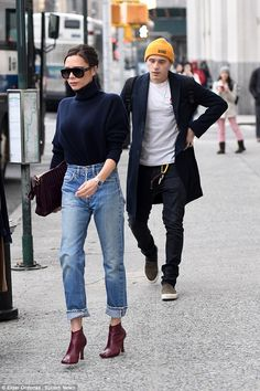 Out and about:Victoria Beckham was still able to take some time out to enjoy some bonding with son Brooklyn as they headed out in the capital on Friday
