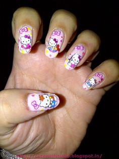 hello kitty nail art @ www.stylecraze.com/photos/nails-photos/hello-kitty-nail-art-10-jpg49139/