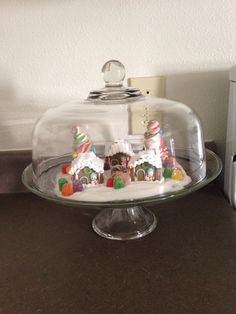 Cake stand as a christmas snow globe!! Candy theme