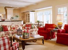 Interior Designer Charles Faudree: French Flair Charles Faudree used a peanut color to warm up the walls in this family room. He decorated the room around the floral sofa - also love the red gingham. Living Room Red, Cottage Living Rooms, Home And Living, Living Room Decor, Dining Room, French Country Living Room, French Country Cottage, Red Cottage, Country Style