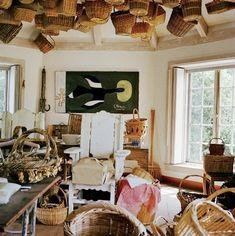 Garden Shed Idea - Hang baskets from ceiling!  Inside Bunny Mellon's Estate | Style | Vanity Fair