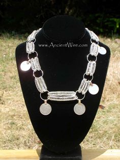 This piece is based on a necklace from the Hameenlinna Linnaniemi treasure hoard.    Ancient Wire-This book will not only show you how to create chains in the style sometimes known as Viking wire weaving, Viking chain knitting, or Viking knit, but how to finish them, and also how to create other items such as rings and hollow ovals.  AncientWire.com http://amzn.to/2gKBZMS