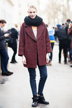 A boxy coat is accessorized with an infinity scard and high-top sneakers.